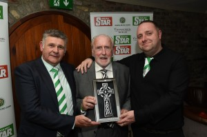Danny McGrain receives a presentation from AICSC committee members Neil Reilly and Frank Cullen.