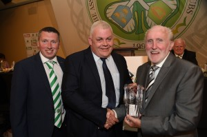 Danny McGrain receives 2018/19 AICSC Young Player of The Year Award on behalf of Kristoffer Ajer from our award sponsor Leo Quinn and AICSC Secretary Neville Carolan